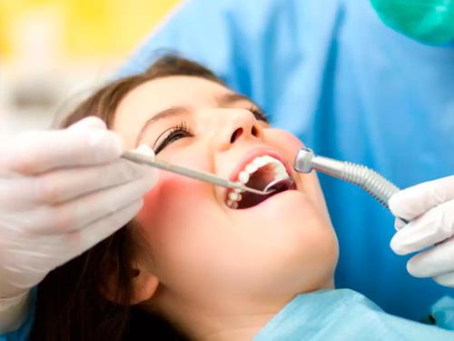 Киста в десне зуба лечение