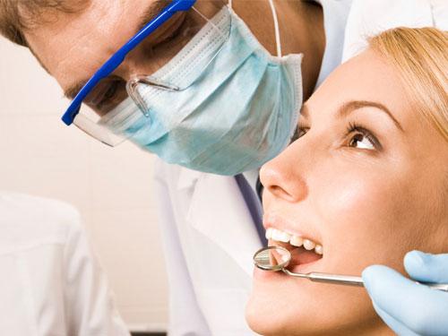 Композитная реставрация зубов цена