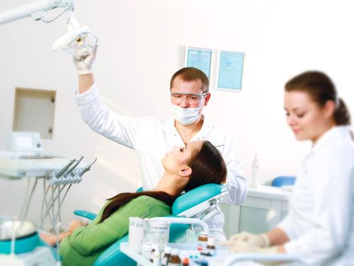 Вставить передний зуб цена