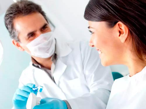 Сколько стоит вставить 2 передних зуба